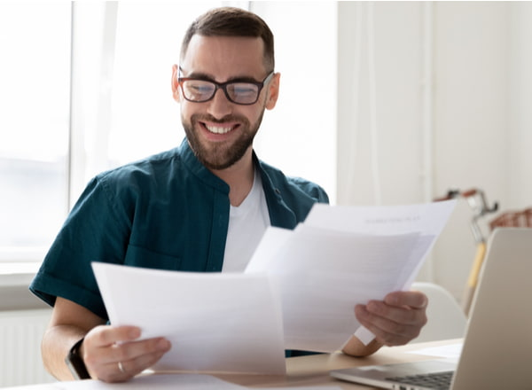 Businessman holding and reading documents