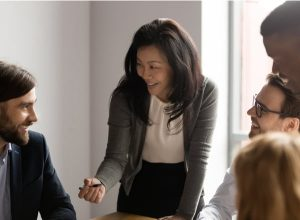 Businesswoman talking to diverse colleagues at meeting