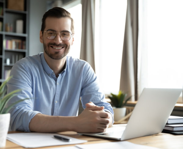 Businessman wearing glasses sitting at work