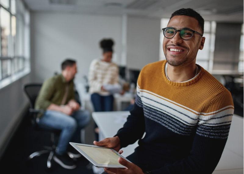 Confident male entrepreneur with digital tablet