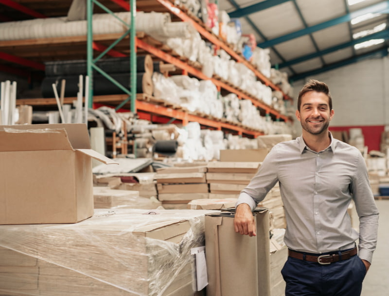 Smiling warehouse manager