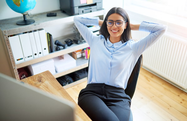 Woman leaning back in chair at work