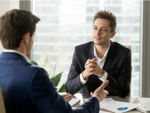 Businessman listening to business partner