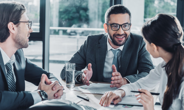 Confident business people having conversation