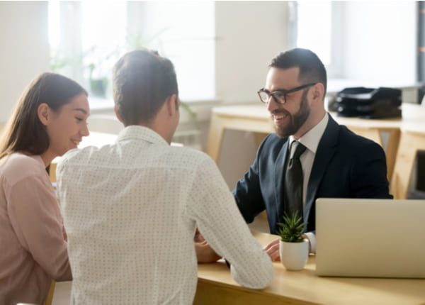 Financial advisor in suit consulting young couple