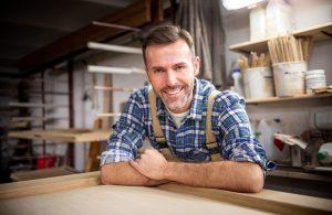 Smiling and proud mature carpenter