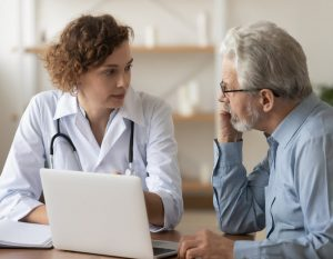 Old male patient consulting to a female physician