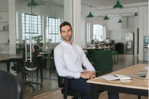 Confident young businessman sitting in a chair