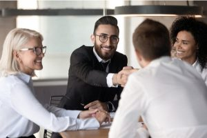 Businessman handshakes client accomplish successful negotiations