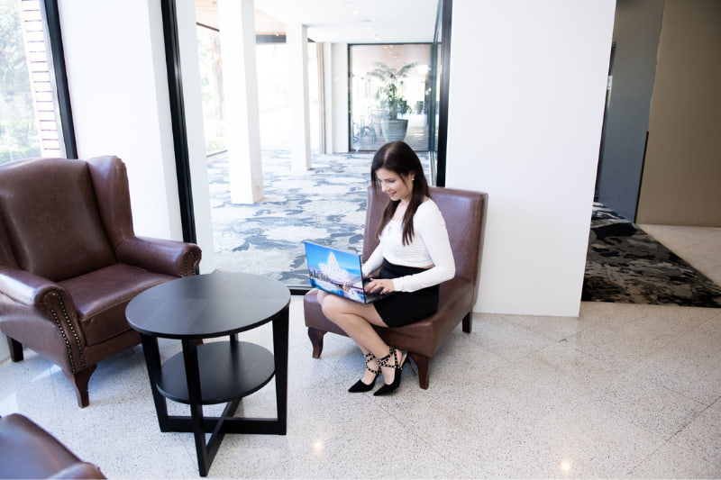 Woman using her laptop at the lobby