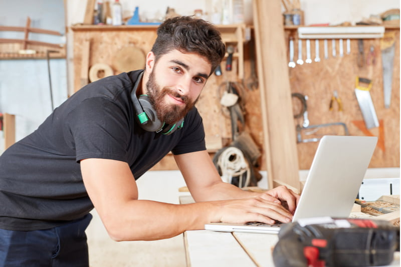Man writes an email as customer service on the laptop