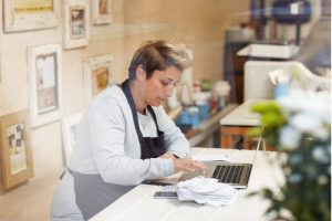 Female owner doing checking all the receipts from her business