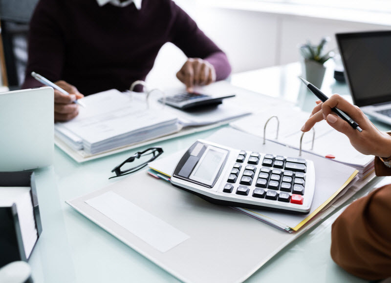 Two business people calculating and checking the finances